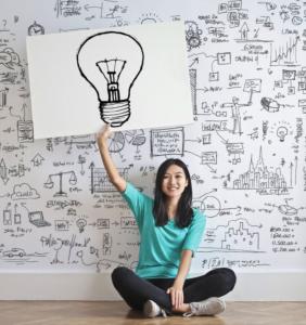 cartoon of girl holding lightbulb